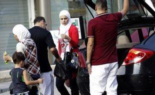 Hani Abdel Malek, le gérant d'un luxueux hôtel de Bhamdoun s'attendait à une mauvaise saison, les riches touristes du Golfe boudant le Liban cet été. Jusqu'à la semaine dernière quand des centaines de Syriens ont afflué à son hôtel pour fuir les combats à Damas.