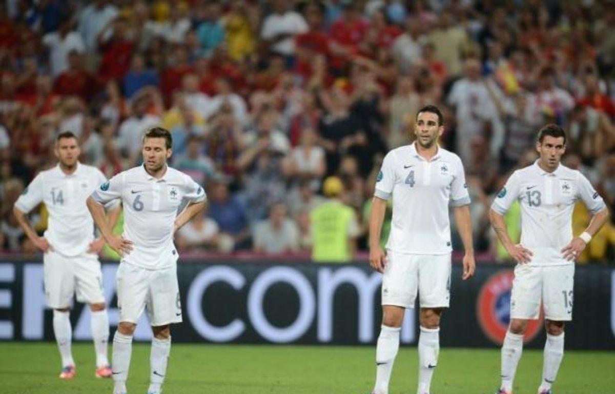 Largement dominée de bout en bout, l'équipe de France n'est pas parvenue à créer l'exploit face aux champions du monde et d'Europe espagnols, vainqueurs 2-0 grâce à un doublé de Xabi Alonso samedi à Donetsk, et quitte l'Euro-2012 au stade des quarts de finale. – Franck Fife afp.com