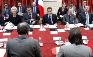 Nicolas Sarkozy, François Fillon, et Christine Lagarde, lors du sommet social à l'Elysée, le 10 mai 2010.