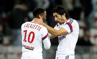 Alexandre Lacazette (L) and Milan Bisevac of Lyon jubilate after the third goal scoring by Lacazette during the French L1 soccer match between OGC Nice and O Lyon, on November 01, 2014 at the Allianz Riviera Stadium in Nice, southern France. FRANCE - 01/11/2014/BEBERT_0111_054/Credit:BEBERT BRUNO/SIPA/1411020930
