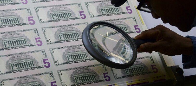 Des billets de 5 dollars (image d'illustration).