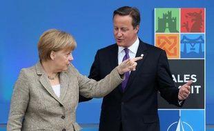 La chancelière Angela Merkel avec le Premier ministre britannique David Cameron lors du sommet de l'OTAN à Newport, dans le Pays de Galles, le 4 septembre 2014
