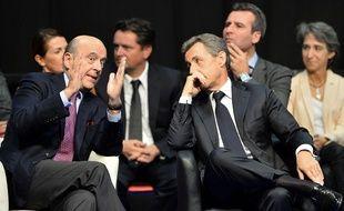 Alain Juppé et Nicolas Sarkozy à Limoges le 14 octobre 2015.