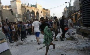 Une maison vient d'être détruite par des frappes aériennes israéliennes à Rafah, dans le sud de la bande de Gaza, le 11 juillet 2014.