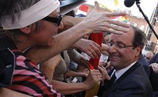 """François Hollande a fait jeudi, lors de son dernier meeting avant le deuxième tour, """"la promesse de Toulouse"""", celle d'être """"un président qui ressemblera au candidat qu(il est)"""", """"un candidat normal, pour une présidence normale, au service de la République"""""""
