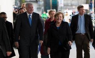 La chancelière allemande Angela Merkel a trouvé un accord mercredi avec le parti social démocrate (SPD) pour un gouvernement commun, deux mois après sa victoire sans majorité absolue aux législatives, ont indiqué à l'AFP des sources proches des négociations.