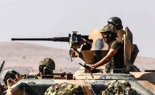 Des soldats turques dans un char dans la ville de Karkamis, le 27 août 2016. AFP PHOTO / BULENT KILIC