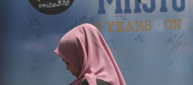 Un panneau accueillant des messages de condoléances pour les disparus du vol MH370, à Kuala Lumpur le 3 mars 2019.
