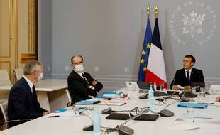French President Emmanuel Macron, right, French Prime Minister Jean Castex, center, and Economy Minister Bruno Le Maire attend a videoconference with representatives of the sporting world at the Elysee Palace in Paris, Tuesday, Nov. 17, 2020. (Ludovic Marin, Pool via AP)/XTC103/20322448523237/12345678/2011171316