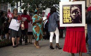 Des militants manifestent le 6 août 2014 à Washington pour protester contre l'inaction des gouvernements pour mettre fin à la violence de Boko Haram et en particulier l'enlèvement des jeunes filles par le groupe islamiste nigérian
