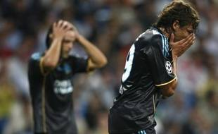 Les deux Marseillais et ex-Madrilènes, Fernando Morientes (à gauche) et Gabriel Heinze, peuvent être dépités, l'OM a sombré face au Real Madrid (3-0), le 30 septembre 2009