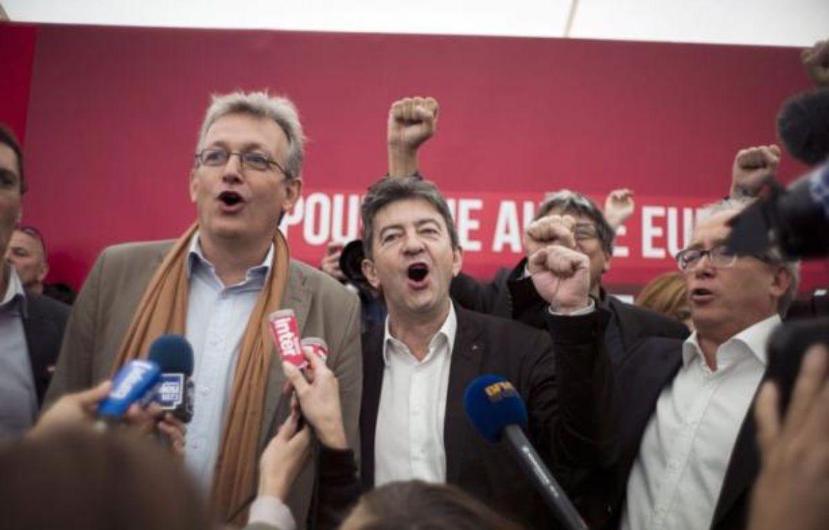"""""""Unis comme les doigts de la main"""": Pierre Laurent et Jean-Luc Mélenchon ont insisté samedi sur leur """"unité"""" lors de la fête de l'Humanité, assurant que le Front de gauche n'est """"pas dans l'opposition"""" au gouvernement. – Fred Dufour afp.com"""