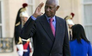 L'ancien président sénégalais Abdou Diouf quitte le palais de l'Elysée le 10 septembre 2014