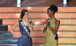Miss  Nord Pas de Calais Iris Mittenaere (L) is selected Miss France 2016 by Miss France 2015 Camille Cerf during the Miss France 2016 beauty contest on December 19, 2015 in Lille. AFP PHOTO / PHILIPPE HUGUEN / AFP / PHILIPPE HUGUEN