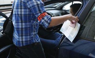 Illustration d'un contrôle de police visant les chauffeurs UberPOP, à Paris le 26 juin 2015.