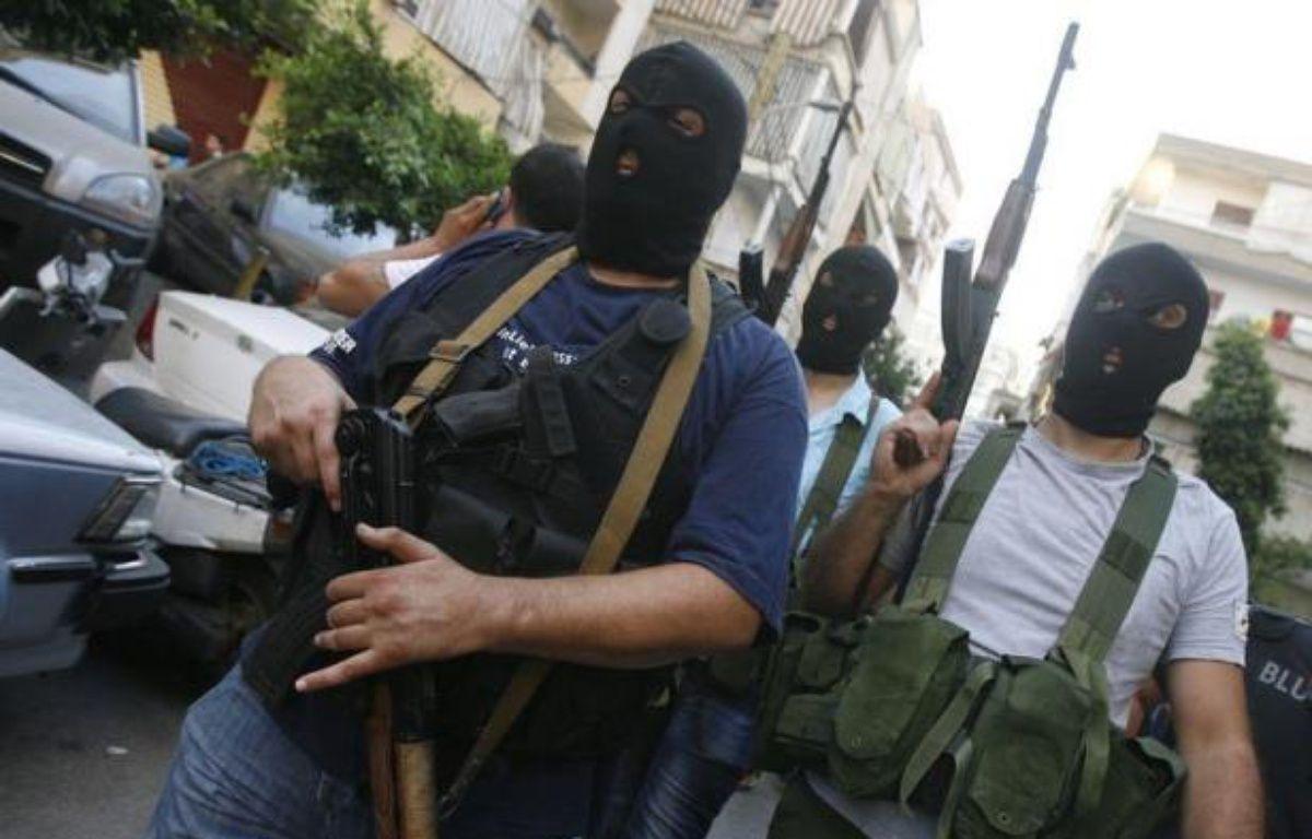 La violence qui ensanglante la Syrie depuis 17 mois a fait tâche d'huile au Liban avec le rapt de dizaines de Syriens, hostiles à Bachar al-Assad, par des hommes armés chiites adversaires déclarés de la rébellion. – - afp.com