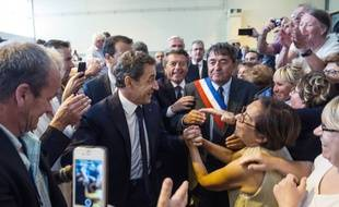 Nicolas Sarkozy auprès de ses militants lors de la campagne pour les élections régionales.