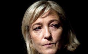 """Marine Le Pen, présidente du FN, a vivement critiqué vendredi le Qatar, accusé """"d'investir massivement"""" et sur une base communautaire dans les banlieues françaises."""