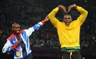"""Usain Bolt a fait un clin d'oeil à Mo Farah en mettant les mains en """"M"""" au-dessus de la tête - le """"Mobot"""" - après avoir franchi la ligne d'arrivée du relais 4x100 m en hommage au Britannique, l'autre star de la soirée d'athlétisme samedi au stade olympique."""