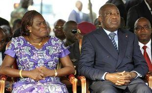 Photo du 4 février 2011 de Simone Gbagbo et de son mari Laurent Gbagbo, alors président de Côte d'Ivoire, à Abidjan