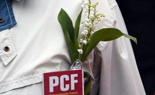Un badge du PCF, le 1er mai 2015 à Rennes