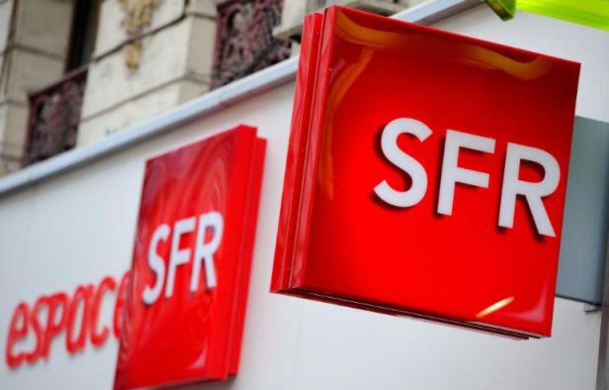 Illustration de SFR, dont la vente au groupe Altice, propriétaire de Numericable, a été décidée en avril. – Philippe Huguen AFP