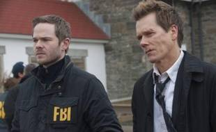 "Shawn Ashmore et Kevin Bacon, dans ""The Following"" (FOX)"