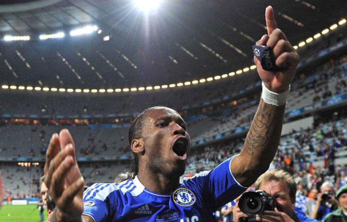 Didier Drogba célèbre la victoire en Ligue des Champions, à l'Allianz Arena de Munich, le 19 mai 2012. – COLORSPORT/SIPA