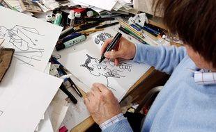 Le dessinateur Cabu dans son bureau.