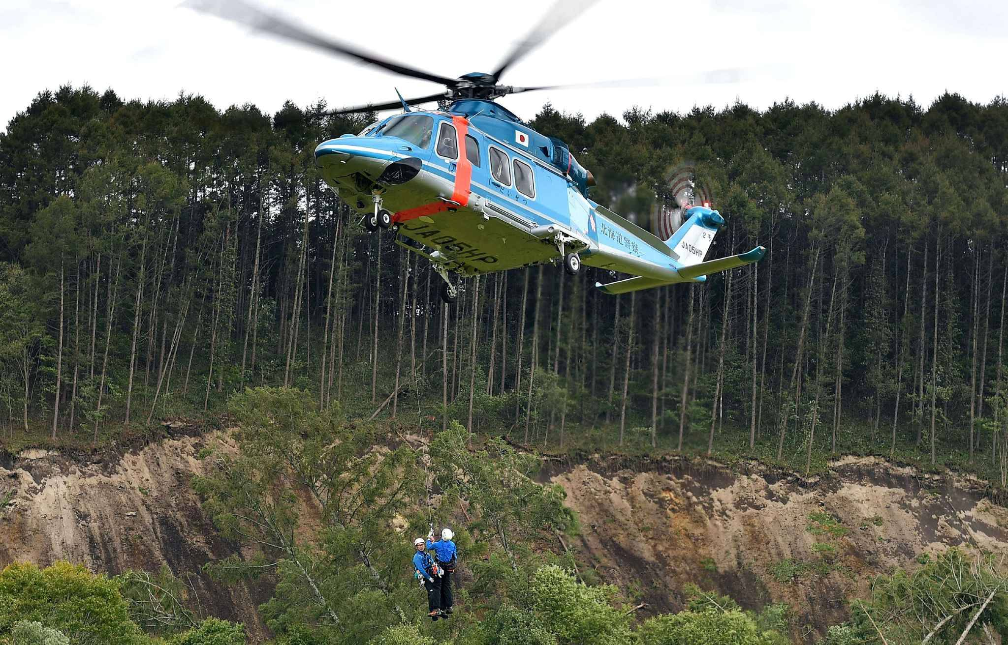 A man is rescued in Atsuma Town, Hokkaido on Sep.6, 2018. The severe earthquake registering a strong 6 on the Japanese seismic scale in Abira Town, Iburi district of Hokkaido occurred at a.m. 3 on September 6th. According to the Meteorological Agency, the depth of the epicenter was estimated to be about 37 kilometers, and the indicative magnitude is estimated to be 6.7.