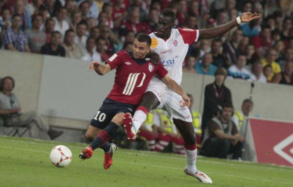 Marvin Martin (à gauche), face à l'ASNancy-Lorraine, le 17 août 2012, au Grand Stade de Lille. – BAZIZ CHIBANE/SIPA