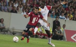 Marvin Martin (à gauche), face à l'AS Nancy-Lorraine, le 17 août 2012, au Grand Stade de Lille.