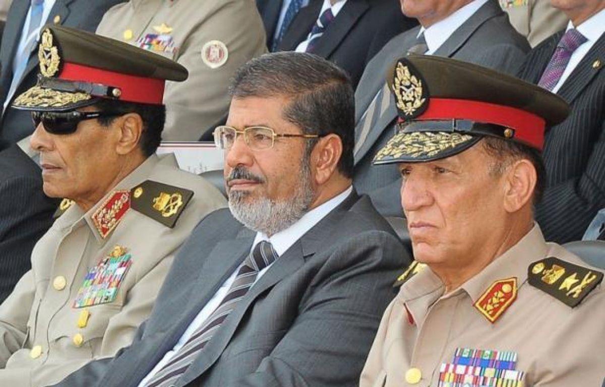 """La décision du président égyptien de rétablir le Parlement dissous a déclenché un séisme politique en Egypte, où certains saluent ce défi à l'égard de l'armée, tandis que d'autres regrettent un """"coup d'Etat constitutionnel"""" témoignant d'un manque de respect pour la démocratie. –  afp.com"""