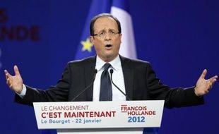 """En meeting au Bourget à trois mois pile du premier tour de la présidentielle, François Hollande s'est lancé avec énergie dimanche dans le combat élyséen en se posant en héritier et défenseur des valeurs de la gauche pour """"changer le destin de notre pays""""."""