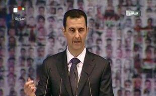 """Le président syrien Bachar al-Assad a appelé dimanche au """"dialogue national"""" après la fin des opérations militaires, tout en regrettant de ne pas avoir jusqu'à présent trouvé de """"partenaire"""" pour mettre en place une solution politique à la crise."""