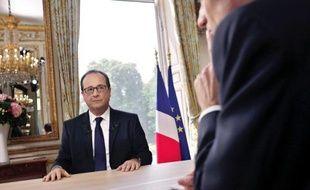 Le président François Hollande au cours de la traditionnelle interview télévisée du 14 juillet à l'Élysée sur TF1 et France 2