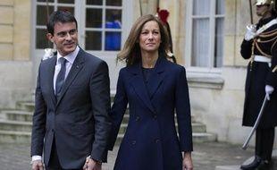 Le Premier ministre Manuel Valls et sa femme Anne Gravoin, le 3 décembre 2014 à l'hôtel Matignon, à Paris