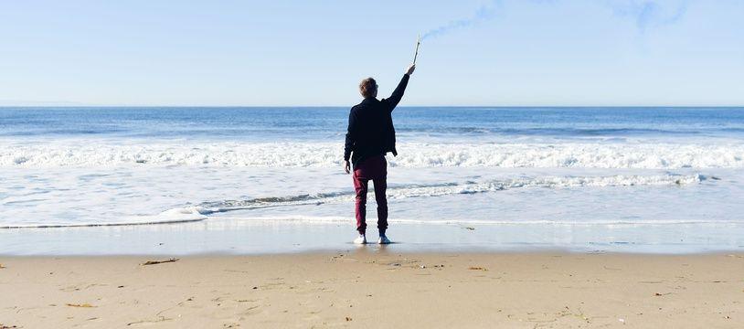 Une personne abandonnée sur la plage, illustration