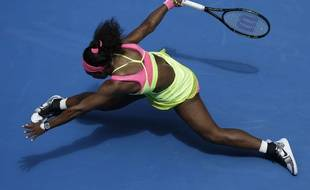 Serena Williams of the U.S. stretches out for a shot to Garbine Muguruza of Spain during their fourth round match at the Australian Open tennis championship in Melbourne, Australia, Monday, Jan. 26, 2015. (AP Photo/Bernat Armangue)/MEL165/269256446264/1501260939