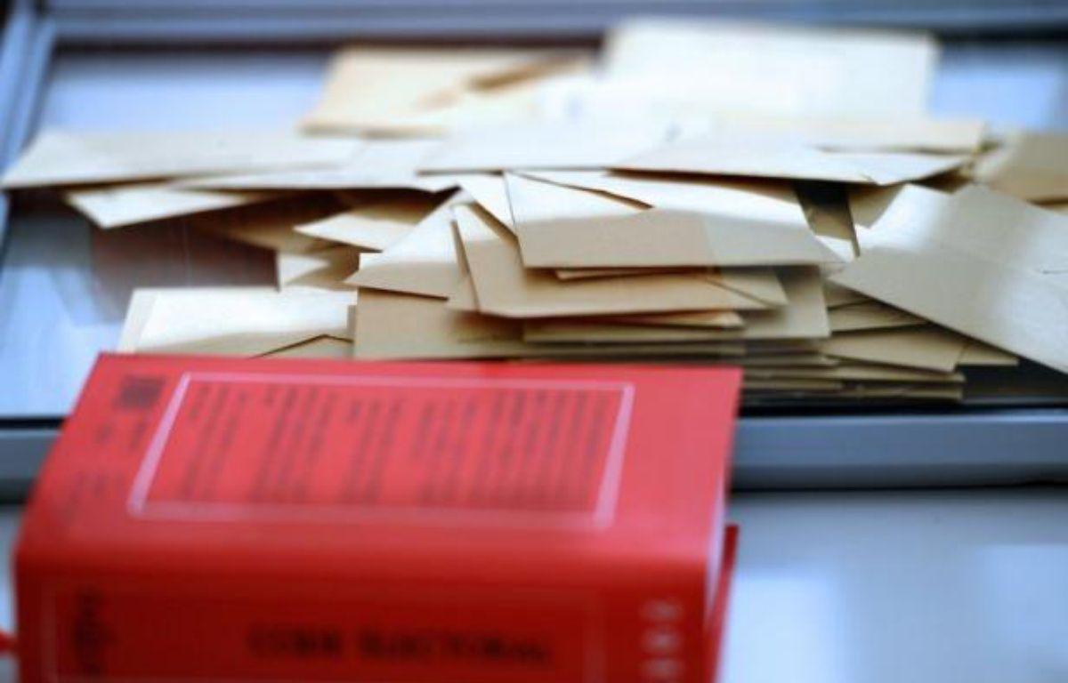 Un nouveau calendrier électoral qui prévoit de repousser les élections départementales et régionales prévues en 2014 à 2015, est à l'étude et sera proposé au vote des parlementaires à la rentrée. – Frederick Florin afp.com