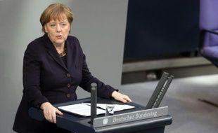 La chancelière allemande Angela Merkel s'adresse au Bundestag, le 17 février 2016 à Berlin,  avant la réunion du Conseil européen à Bruxelles