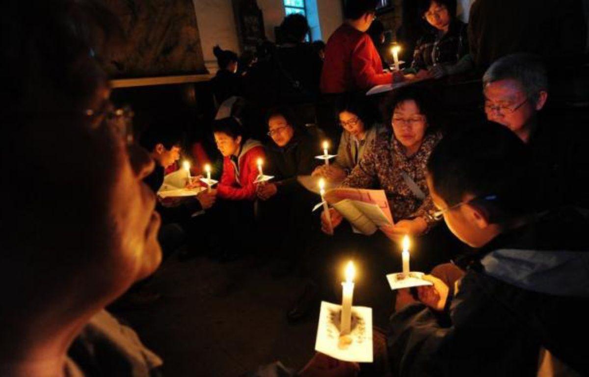 """Pékin a réfuté jeudi les récentes critiques américaines sur les libertés religieuses en Chine, en demandant aux Etats-Unis d'abandonner leurs """"préjugés"""". – Mark Ralston afp.com"""