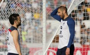 FILE - In this June 10, 2014 file photo, France's Mathieu Valbuena, left, and Karim Benzema, right, chat during a training session of the french national soccer team, at the Santa Cruz Stadium in Ribeirao Preto, Brazil. Benzema has been arrested Wednesday Nov.4, 2015 as part of an investigation into a blackmail case involving another football player. Police are trying to find out which role the Real Madrid forward played in the extortion attempt targeting France midfielder   Valbuena, and if he actually tried to blackmail the Lyon player over a sex tape. (AP Photo/David Vincent, File)/PAR101/159648384293/JUNE 10 2014 FILE PHOTO/1511041346