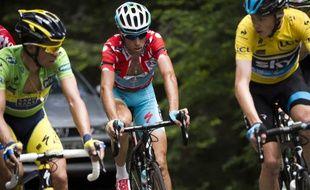 Les coureurs cyclistes Alberto Contador, Vincenzo Nibali et Christopher Froome lors du Criterium du Dauphiné Libéré, en juin 2014.