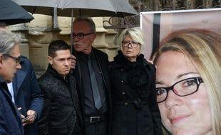 Jonathann Daval, époux de Alexia, et les parents de la jeune femme tuée, le 8 novembre 2017 à Notre-Dame de Gray pour une cérémonie (Haute-Saône)