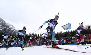 Emilien Jacquelin of France, center, Johannes Thingnes Boe of Norway, right, and Quentin Fillon Maillet of France, 2nd left, compete during the men's 15 km mass start competition at the Biathlon World Championships in Antholz, Italy, Sunday, Feb. 23, 2020.