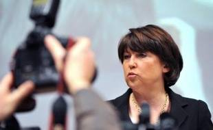 """Martine Aubry, maire PS de Lille et présidente de la communauté urbaine, a déclaré samedi qu'elle se poserait la question de sa candidature ou non à la succession de François Hollande à la tête du PS, une fois que le projet socialiste serait """"prêt""""."""