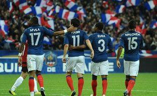 Yann Mvila, Samir Nasri, Patrice Evra et Florent Malouda (de g. à dr.), célèbrent le deuxième but de l'équipe de France contre l'Albanie, vendredi 7 octobre 2011, au Stade de France.