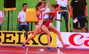 L'Américaine Molly Huddle s'est fait devancer à la dernière seconde par sa compatriote Emily Infeld aux 10.000 mètres femmes des championnats du monde d'athlétisme à Pékin (Chine), le 22 août 2015.