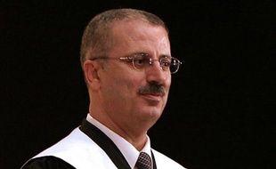 Le nouveau Premier ministre palestinien Rami Hamdallah, un universitaire peu connu à l'étranger, a affirmé vouloir suivre la voie de son prédécesseur Salam Fayyad, puis céder rapidement la place à un gouvernement d'union nationale, en vue de la réconciliation avec le Hamas.